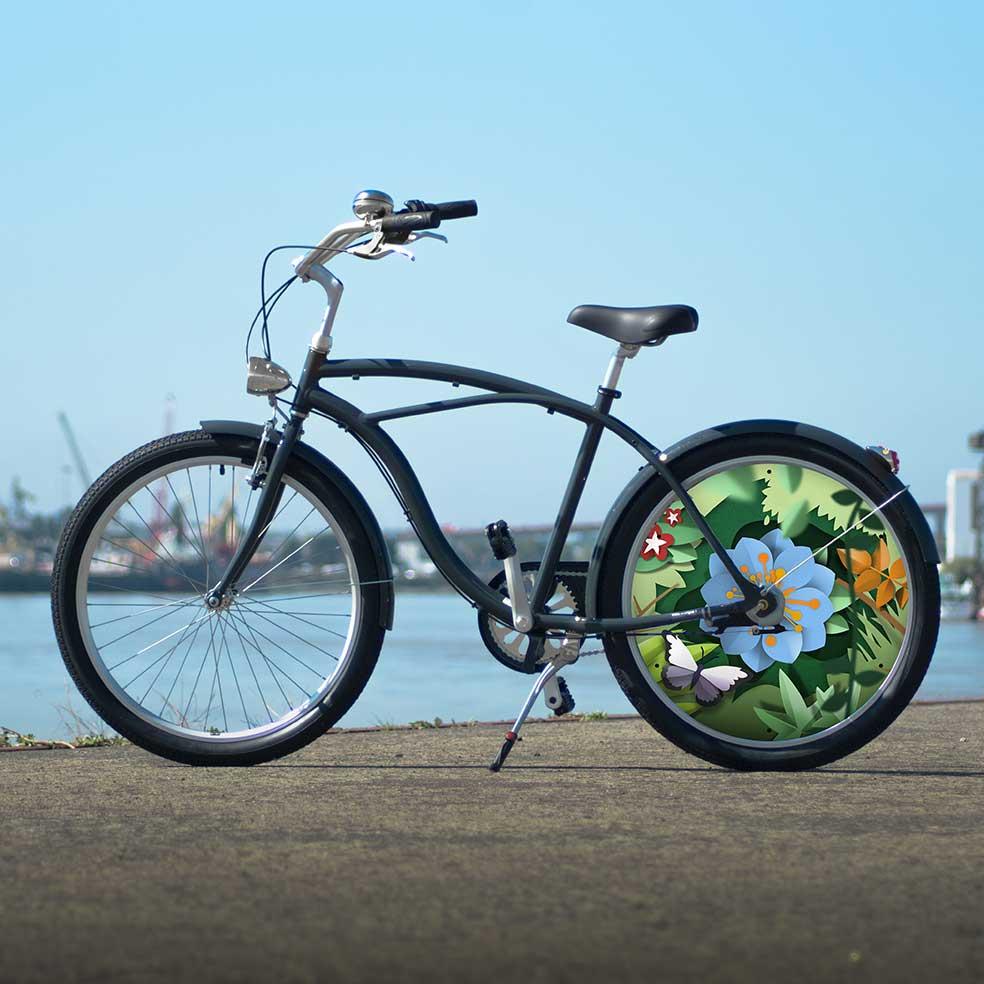 Vélo de collection Canopée. Vélo de ville Cruiser avec une roue arrière au design floral. Roue lenticulaire du plus bel effet pour des trajets en toute simplicité