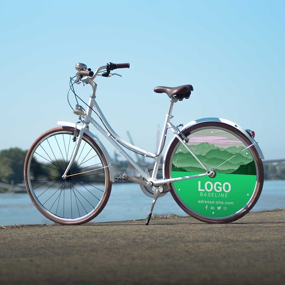 Vélo de fonction Coffee Mixte, habillage 1 enjoliveur. Roue lenticulaire à l'arrière aux couleurs et logo de l'entreprise. Idéal pour déplacements en ville ou vélotaf