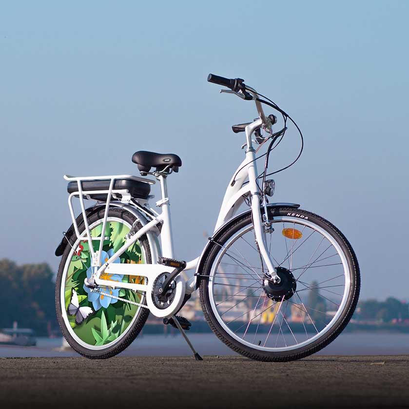 VAE collection Canopée, le E-Colors au design fleuri. Roulez électrique en ville avec un vélo qui conviendra aussi bien aux femmes qu'aux hommes